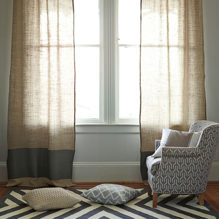 Color Block Window Panel, patterned chair, striped rug. great mix of neutrals and bold