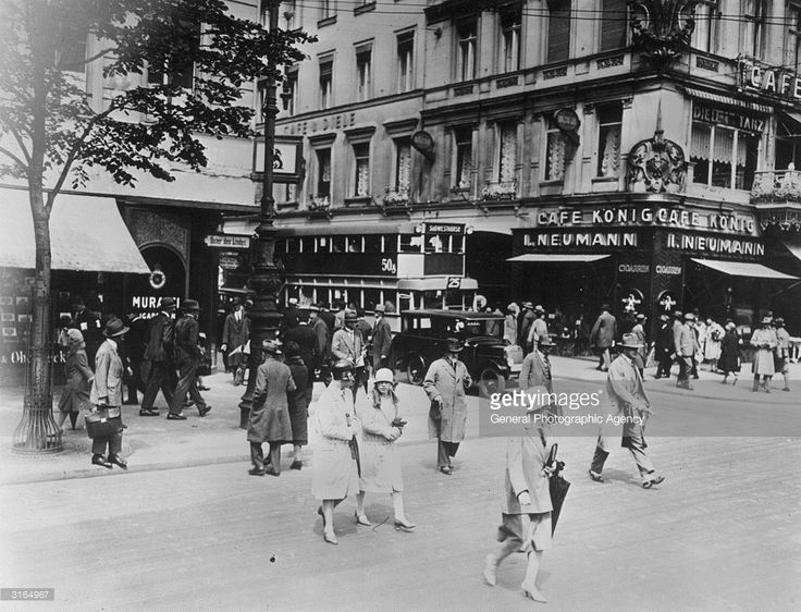 People walking past Cafe Konig at Unter Den Linden, Berlin
