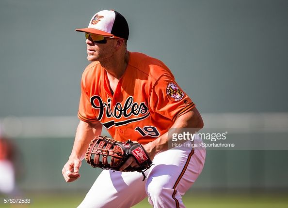 News Photo : Chris Davis of the Baltimore Orioles defends his...