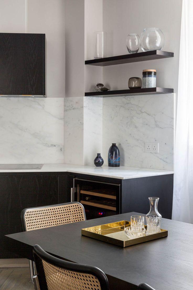 Dark matte cabinets, white thin top
