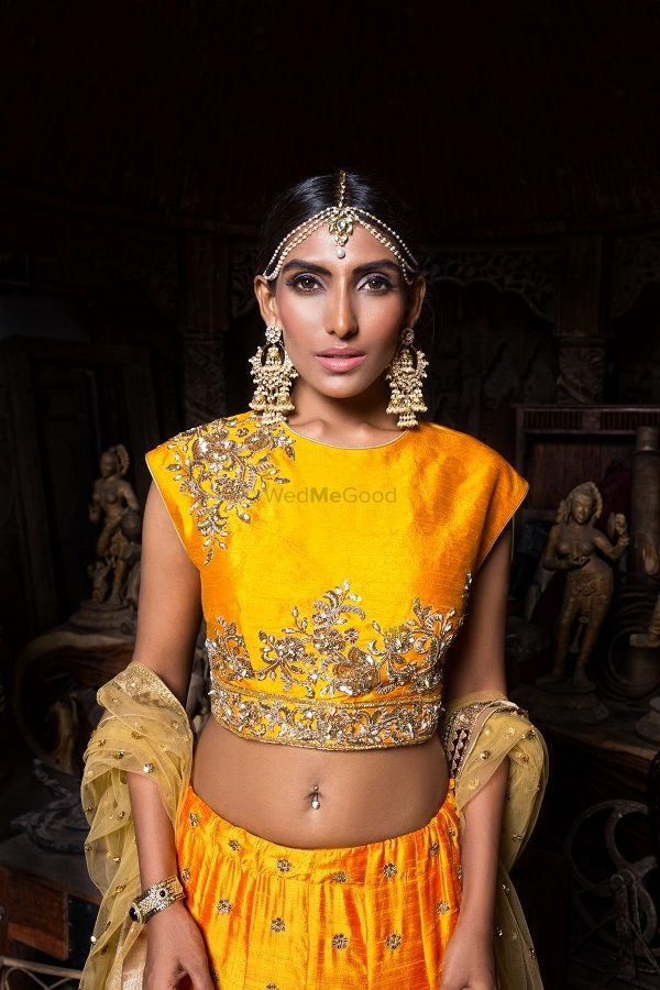 A mustard yellow outfit in raw silk with a boat neck blouse and stunning jewellery| WedMeGood|#wedmegood #indianweddings #lehenga #rawsilklehenga #bridaljewellery