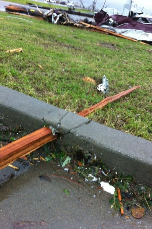 This is the picture that struck me the most in the after math of Joplin's tornado. I just can't get over how wood can pierce through cement b/c the force on the tornado is so powerful.