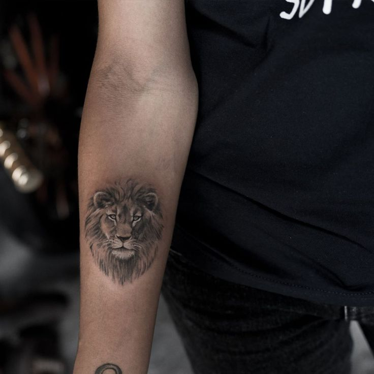 small lion head tattoo on forearm by niki23gtr