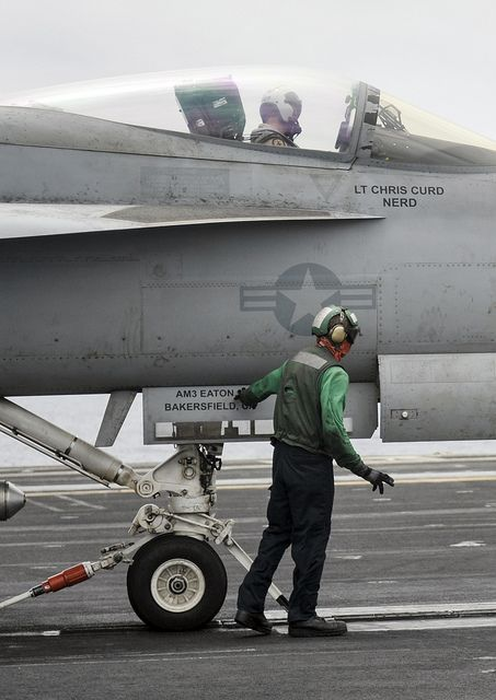 "NORTH ARABIAN SEA (July 19, 2013)—An F/A-18E Super Hornet from the ""Argonauts"" of Strike Fighter Squadron (VFA) 147 prepares to take off from the flight deck of the aircraft carrier USS Nimitz (CVN 68). Nimitz Strike Group is deployed to the U.S. 5th Fleet area of responsibility conducting maritime security operations, theater security cooperation efforts and support missions for Operation Enduring Freedom."
