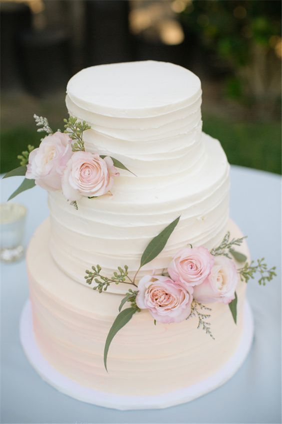 A three tier wedding cake with a classy vibe - love it!