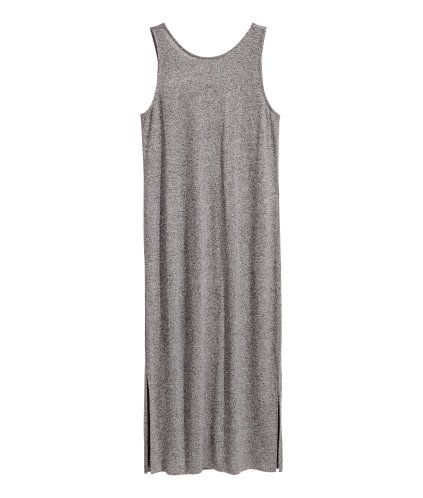 Black. Knee-length, sleeveless jersey dress in a viscose blend with a deep neckline at the back and slits in the sides.