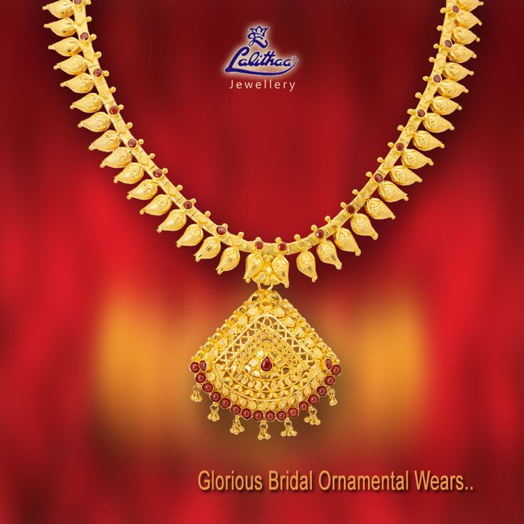 Kerala style neck piece amalgamated with set of golden buds attached to triangular pendant fixed with red stones in between. #LalithaaJewellery.