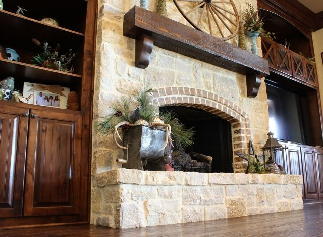 We all love living in Texas, and what says Texas better than stone fireplaces and rich stained woodworking, along with a rugged fireplace mantle and personal decor additions. Home design by Trent Williams Construction, Tyler, Texas