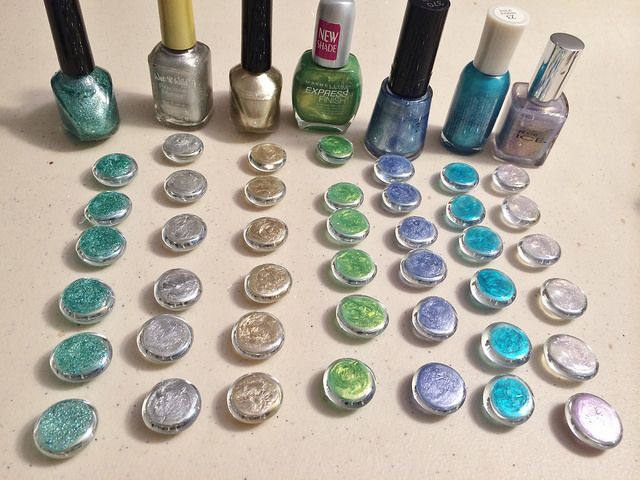 Use nail polish on flat glass marbles to get the perfect color for jewelry, vases, or table decoration!