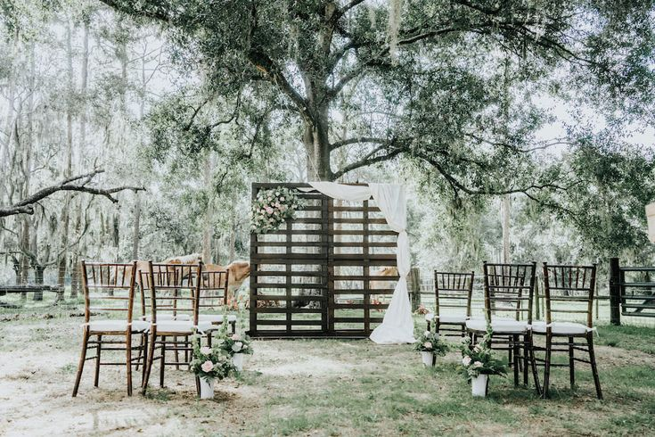 Rustic Garden Wedding Ceremony with Wooden Pallet Ceremony Backdrop with Flowers and White Drapery