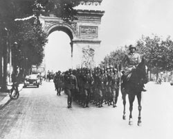 A German military unit, marching down the Champs-Élysées; Paris, 4 July 1940 - In May of 1940 Germany invaded France. Learn about the Holocaust in France