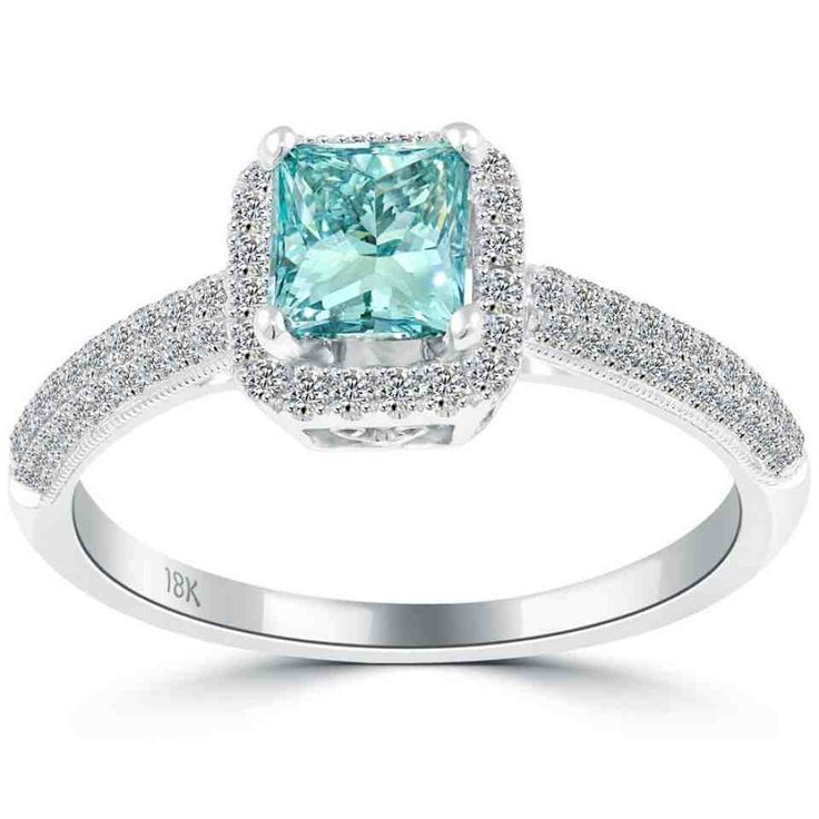 this classy and traditional blue diamond engagement ring is set with ultra stunning diamonds the princess cut fancy blue center diamond is surrounded by a