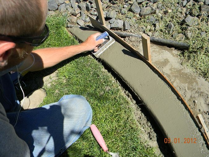 DIY Concrete Landscape Edging. I like the idea of setting pebbles or brick in the wet concrete.