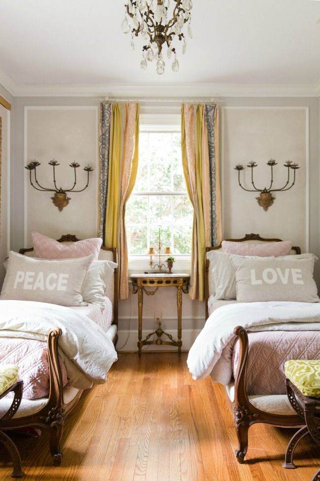 guest bedroom filled with French antiques