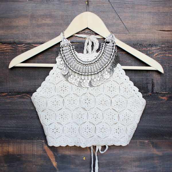 Cream colored halter crochet crop top that features a tie neck and back. Fully lined. Imported. Digging the boho vibe. Seen styled with our floral kimono jacket, antalya turkish coin collar, black boo