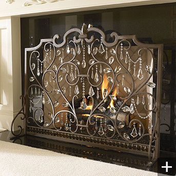 The drop crystals are beautiful. Repin: Gorgeous fireplace screen from Frontgate! Yes please!!!