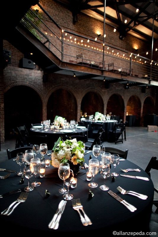 black linens: Bulbs Lights, Elegant Centerpieces, Black Linens, Low Centerpieces, Black Tables, Brick Archway, Dramatic Architecture, Industrial Wedding, Black Tablecloths