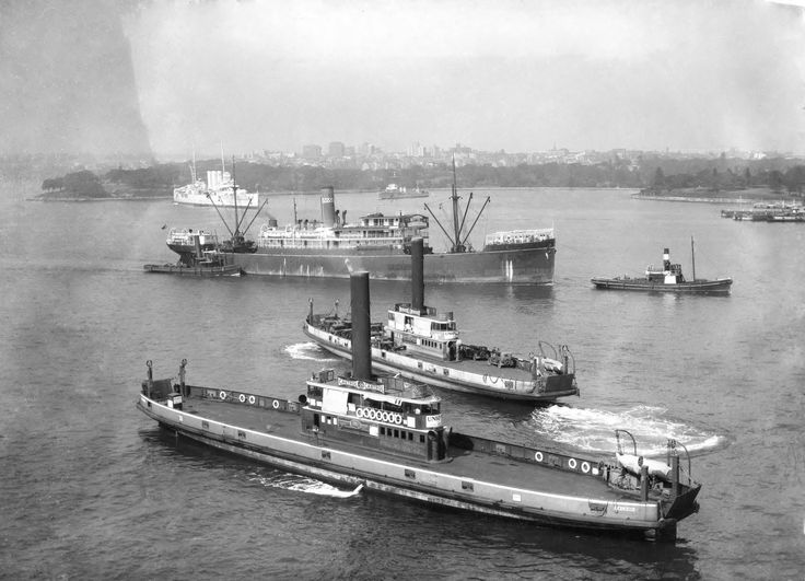 An undated photo of Sydney Harbour Vehicular Ferries 'Kalang' and 'Koondooloo' with HMAS Canberra and HMAS Anzac in the background.
