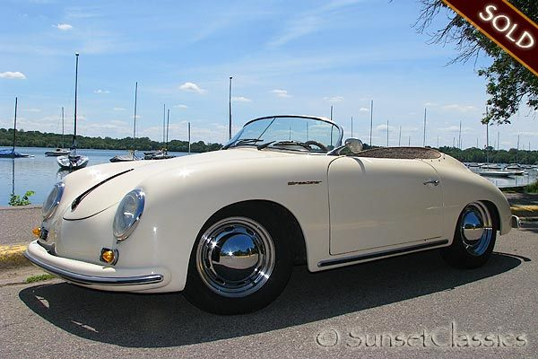 cream color car with brown leather interior.....that's a beauty!  of course...it's a 1956 porsche.