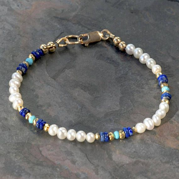 This delicate pearl bracelet features small (3-4mm) off round cultured white pearls, with good luster (real pearls, not shell or Swarovski), accented with genuine deep blue lapis lazuli and authentic sleeping beauty turquoise beads. The blues are set off from each other and from