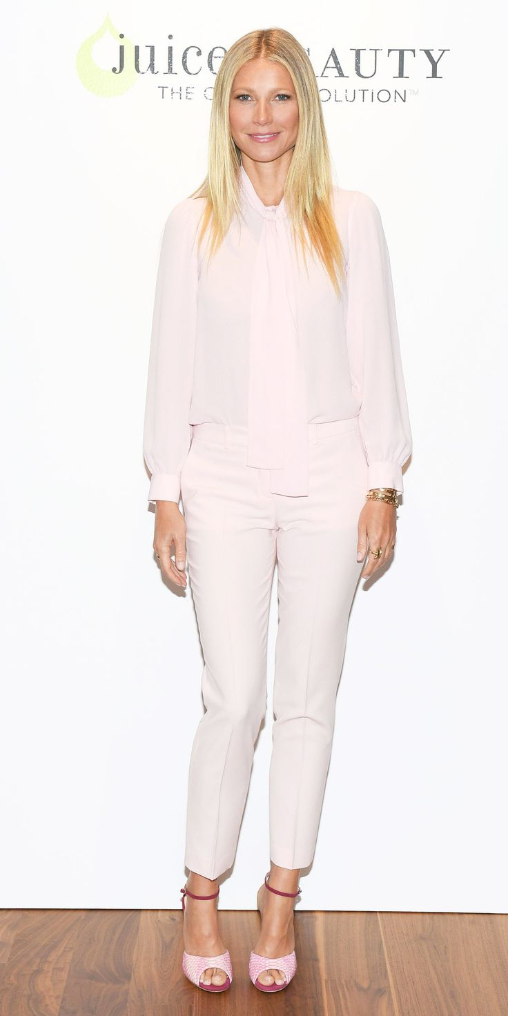 Gwyneth Paltrow sweetened up for her appearance at a Juice Beauty event in Toronto in a blush silk-georgette bow blouse and skinny pants, both by Michael Kors Collection, with pink croc Chloe Gosselin sandals.
