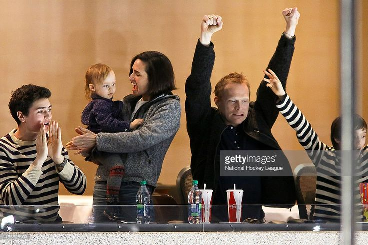 Oscar winning actress Jennifer Connelly (center), husband Paul Bettany (right) and their children cheer on the Winnipeg Jets during second period action against the Carolina Hurricanes at the MTS Centre on March 30, 2013 in Winnipeg, Manitoba, Canada. The Canes defeated the Jets 3-1.