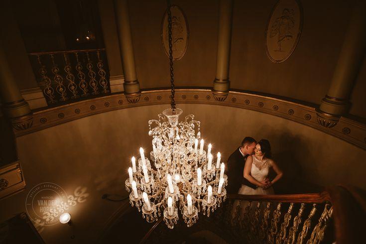 Grand staircase chandelier couple pose idea  Melbourne Wedding & Commerical Photographer Marcel Van der Horst