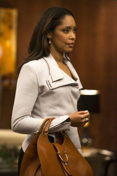 Actress Gina Torres as Jessica Pearson in Suits.  Great to see a strong female character and what a wardrobe!!