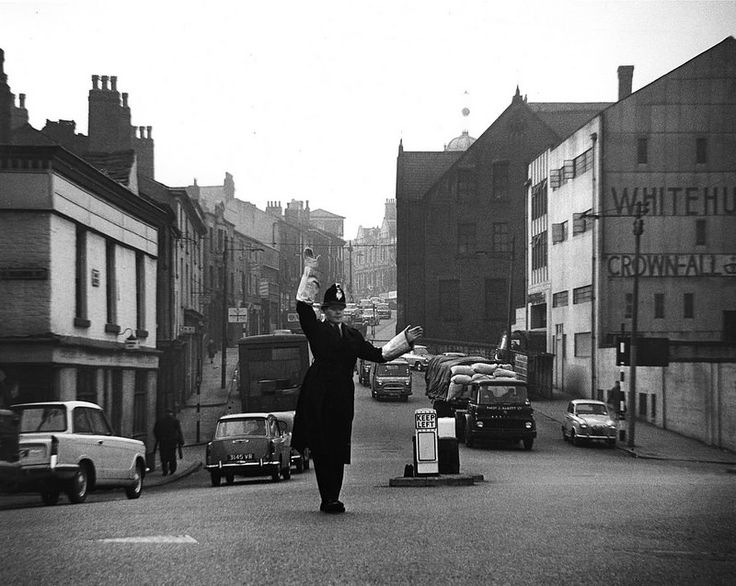 An officer of Bolton Borough Police on traffic control duty in the town. We think this image dates from sometime in the mid 1960s. It is all but forgotten today, but for many decades police officers controlled junctions during busy periods. This practice was known as point duty and each officer would be allocated a 'point' and set times at which they were to attend. www.gmpmuseum.co.uk