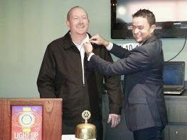 Past President Michael Kirwan inducting new president for 2014-15 - Todd Sheldon