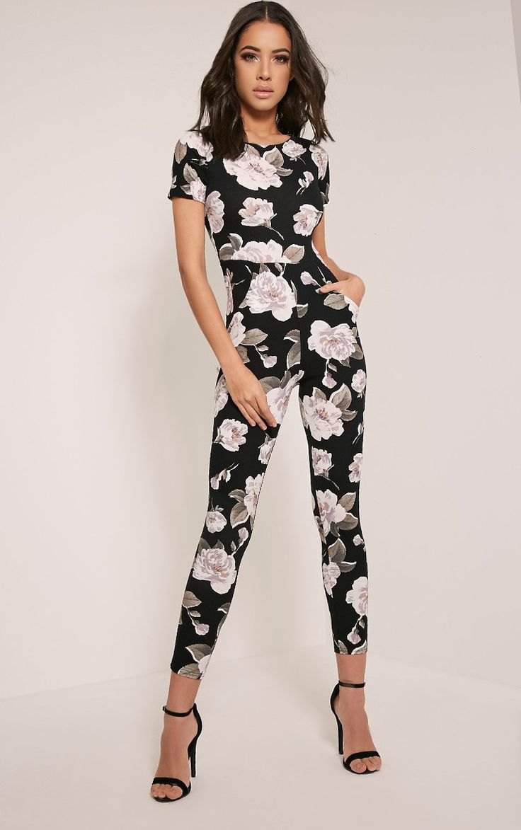 Ivory Floral Printed Jumpsuit Make a statement this season and switch up your dresses for jumpsu...