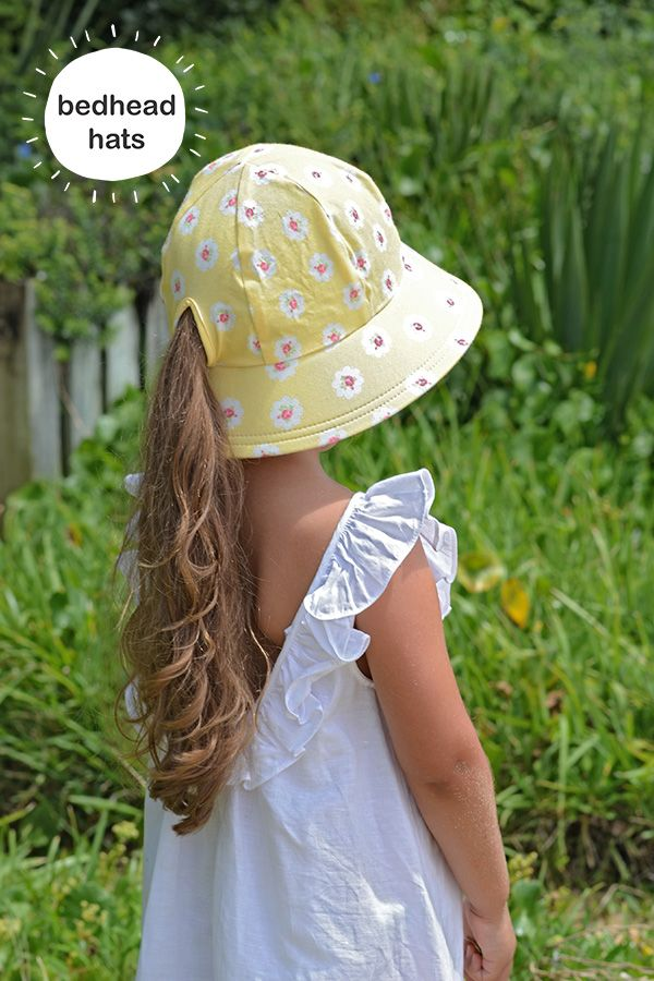 Bedhead Hat's girls buckets ponytail hole keeps necks cool on a warm summer's day and provided excellent sun protection. This summer print is called 'Olivia' in lemon #bedheadhats #kidshats #kidsfashion