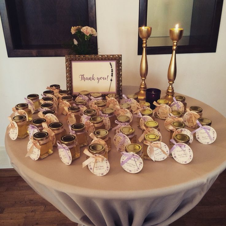 Favors table .. Gold and purple shades.. Made by Danielle Design