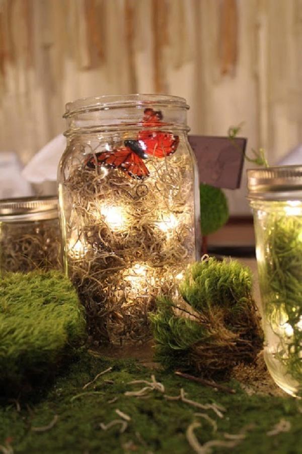 mason jar butterfly & moss lanter wedding table decor / http://www.deerpearlflowers.com/moss-decor-ideas-for-a-nature-wedding/3/