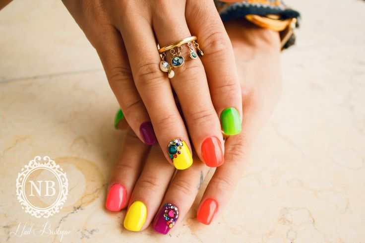 Colored nails and a beautiful accessory