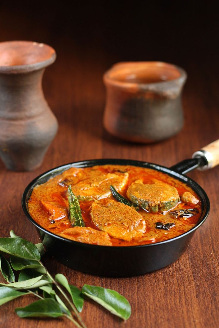 Kerala style fish curry.fish cooked in roasted coconut and chili based gravy.