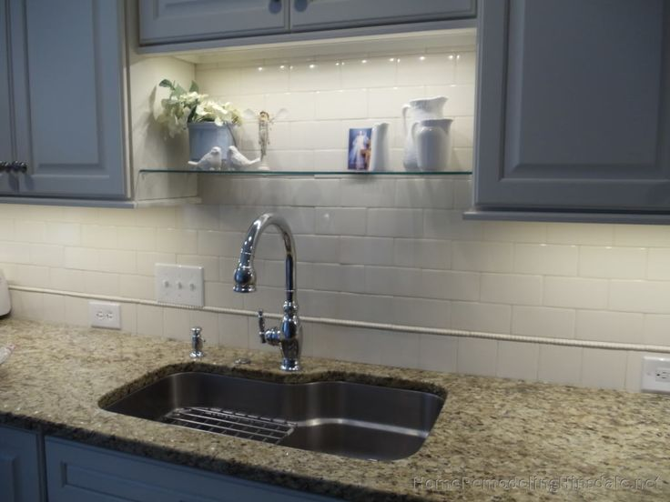 Light And Shelves Above Kitchen Sink
