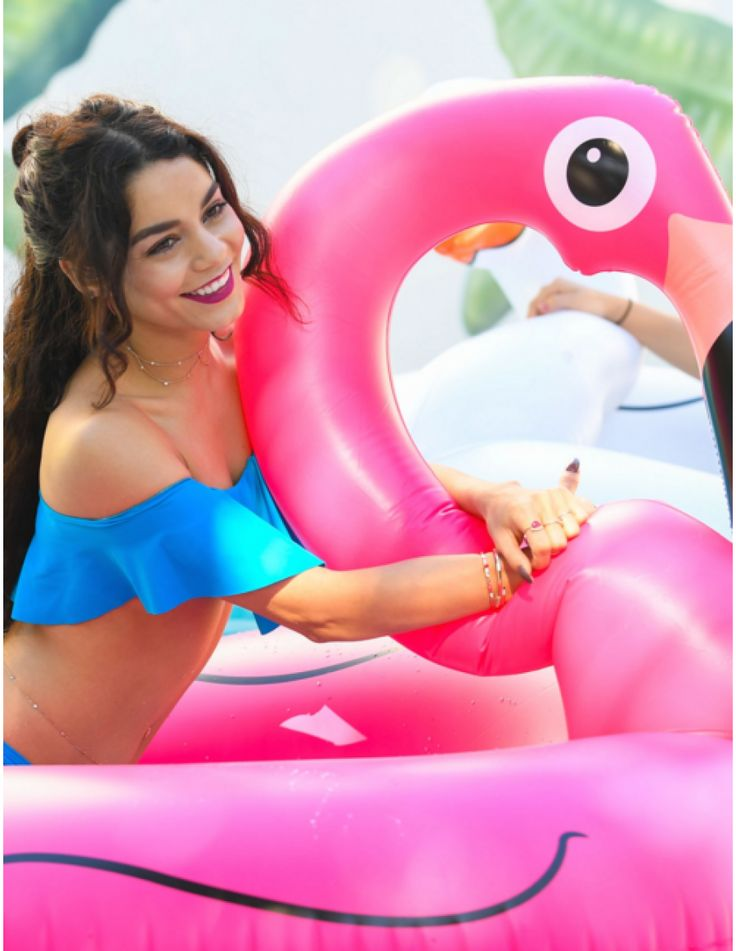Vanessa Hudgens loves the pink flamingo pool float and so do we! Shop this and other fun summer pool floats at AlwaysFits.com.