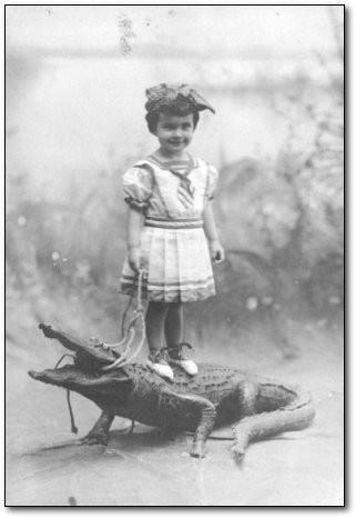 Girl on crocodile