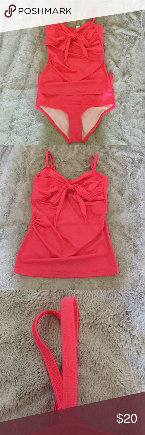 Asks Maternity two piece Tankini Bow Swimsuit Great condition only worn twice. Small amount unravelling on strap. Straps are adjustable and detachable. Bottoms can be worn folded over or regular depending on how much coverage you want. Asos Maternity Swim
