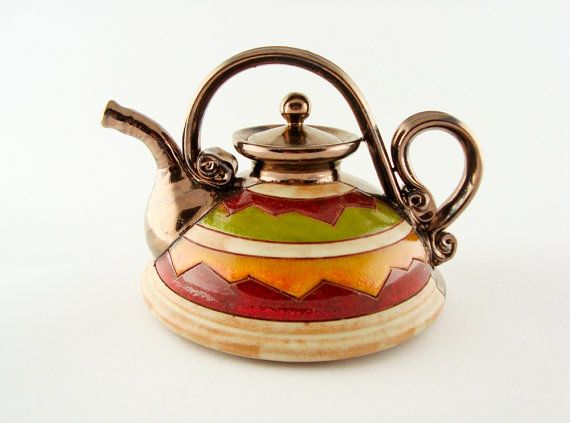 Handmade teapot from a small art pottery studio in eastern europe. Made of black clay and hand carved.