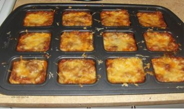 Mini Lasagnas in Pampered Chef Brownie Pan :)