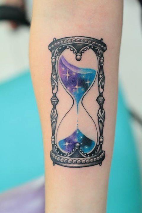 Coloured timer tattoo on lower arm