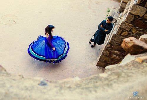 love everything about this photo, from the dulha's stance to the vivid blue of her dress. #couple