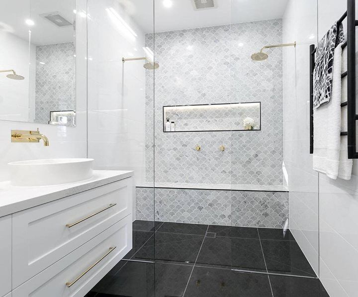 We're swooning over those tiles (and towels) used by @juliaandsasha in their luxe Master Bathroom! Shop the look at The Block Shop now. #9theblock #roomreveals http://ift.tt/2c1nEGw