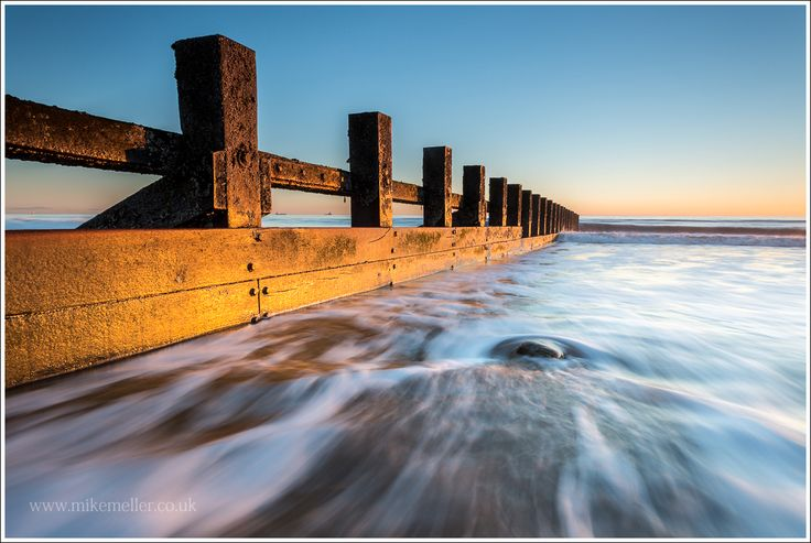 Highlighted Breakwater During Sunrise in Aberdeen, SCOTLAND. Landscape Photography