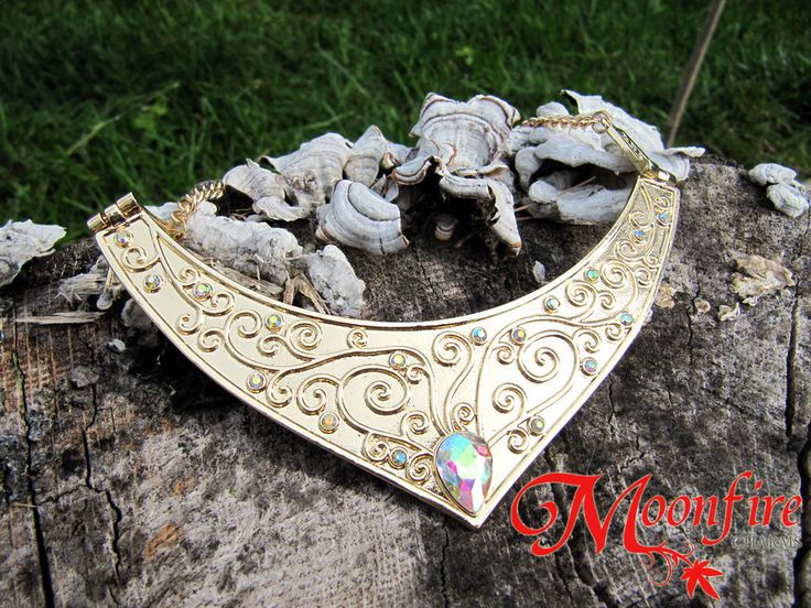 This intricately crafted crescent necklace is inspired by the one worn by Princess Aurora in Sleeping Beauty. Perfect for your Aurora costume or cosplay! The gold plated necklace measures 20 inches lo