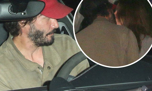 Keanu Reeves is spotted canoodling with mystery brunette