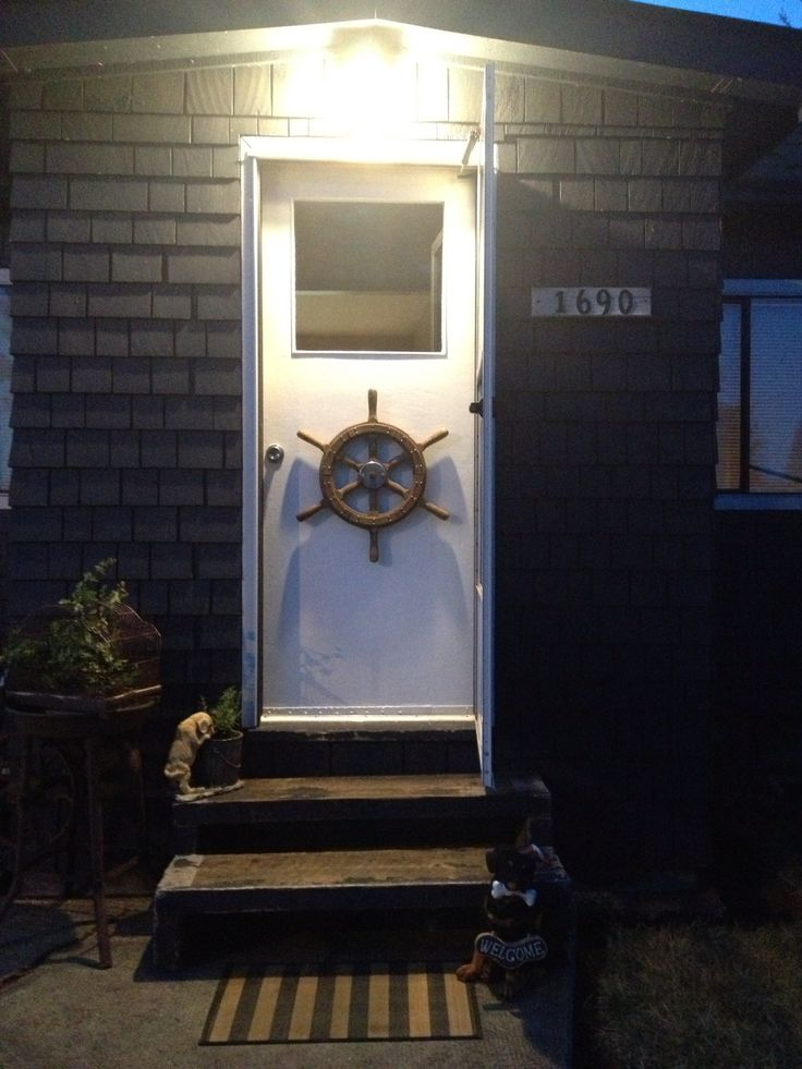 Wheel from my dads old tug boat on front door