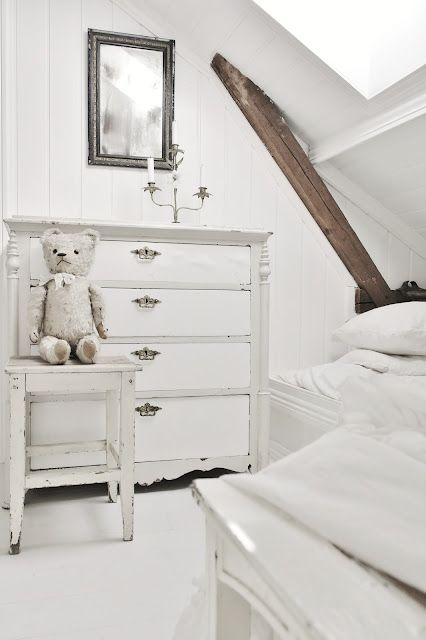 White Shabby Chic Attic Bedroom - I know there is no ruffle or lace, but it still feels like Shabby Chic.